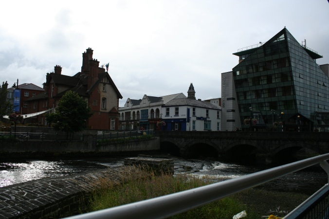 Left, the Yeats Memorial Building.  In between is the Hyde Bridge over the Garavogue River, and the Glasshouse Hotel on the right.