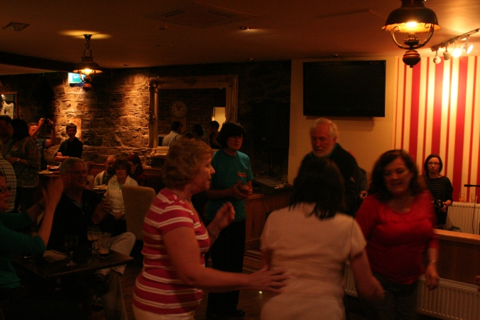 A group of dancers joined the trad musicians at The Harp Tavern on Monday night.